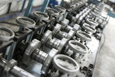 Sheet metal profiles production machine close up — ストック写真