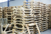 Wooden pallettes in production hall — Stock Photo
