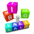 Stock Photo: 3D People with word big sale made from colorful blocks
