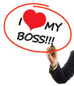 Businessman hand with felt tip marker writing text I love my boss with heart shape — Foto de Stock