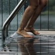 Woman to leave the pool, feet — Stock Photo