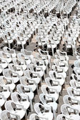 Rows of chairs for outdoor dehors alfresco bar and live gig conc — Stock Photo