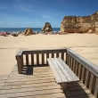 Stock Photo: Beach with bench