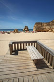 Beach with bench — Stock Photo