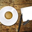 Coffee, with pen and notes — Stock Photo