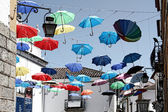 Évora, Portugal umbrella different colors — Stock Photo