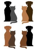 Set of dogs and cats silhouettes — Stock Vector