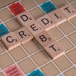 Stock Photo: Credit Debit Scrabble Concept