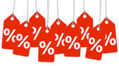 Red hangtags with percent sign — Stock Vector