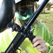 Paintballer with marker gun — Stock Photo