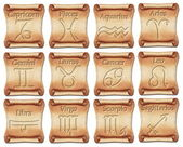 Set of zodiac symbols on ancient scrolls — Stock Photo