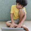 Kid with laptop — Stock Photo #12106140