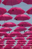 Pink umbrellas — Stock Photo