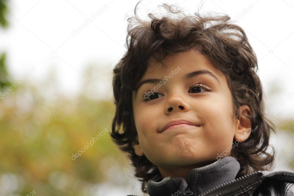 Outdoor portrait of an attractive boy — Stock Photo #14027352