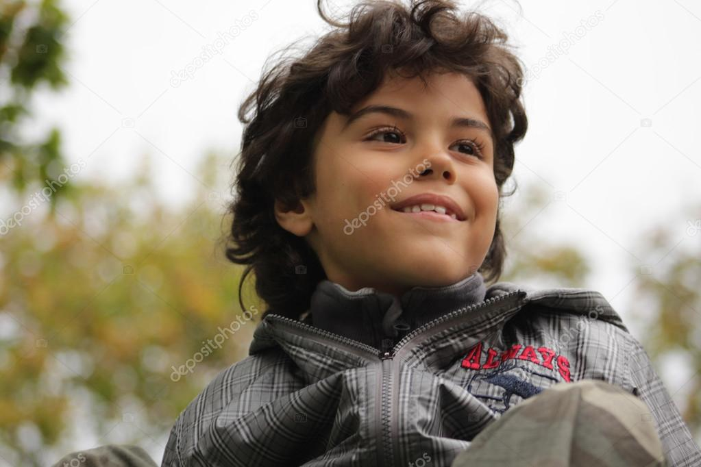 Outdoor portrait of an attractive boy — Stock Photo #14027360