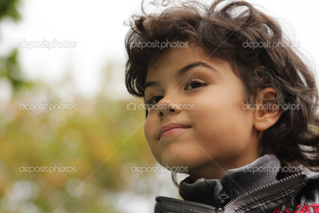 Outdoor portrait of an attractive boy — Stock Photo #14027361