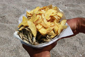 Chips and fried sprat fish — Stock Photo