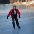 Ice skating on frozen lake — Stock Photo