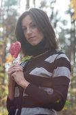 Cute girl with lollipop heart — Foto de Stock
