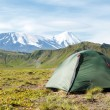 Volcano landscape with tent on Kamchatka — Stock Photo