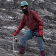 Mountaineer on a glacier — Stock Photo
