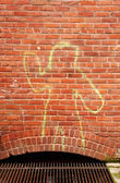 Yellow Outline Person and Brick — Stock Photo