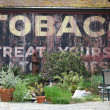 Old Tobacco Billboard - Stock Photo