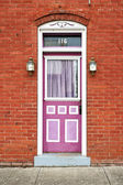 Purple Door and Red Wall — Stock Photo