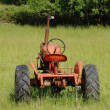 Old Tractor in a Field — Stock Photo #21652409