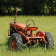 Old Tractor in a Field — Stock Photo #21652447