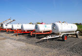 Anhydrous Ammonia transport tanks outside a chemical and fertilizer company in Klamath Falls OR — Stock Photo