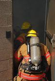 Firefigher and smoke — Stock Photo