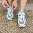 Girl Tying Running Shoes — Stock Photo #32066599