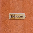 Wooden Toilet Sign on The Orange Wall — Stock Photo