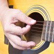 Close up of hand playing acoustic guitar. — Stock Photo
