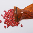 Red supplement tablets. — Stock Photo