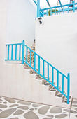 Beautiful ladder with blue handrail. — Stock Photo