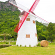 Windmill, hay roll, green field and canal. view in farm. — Stock Photo