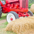 Heap of hays with farmer's vehicle. — Stock Photo