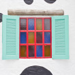 Colorful window with camouflage wall. — Stock Photo