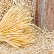 Stock Photo: Sheaf of wheat on hay.
