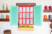 Colorful window with decorating stuffs. — Stock Photo