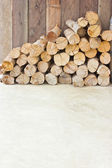 Pile of dry firewood on the ground with copy space. — Stock Photo
