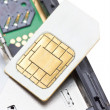 Close up of cell phone and sim card. — Stock Photo #32162827