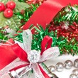 Silver Christmas bells decorating with red ribbon. — Foto de Stock