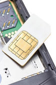 Close up of cell phone and sim card. — Stock Photo