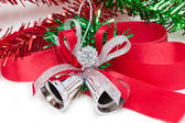 Christmas silver bell with red ribbon isolated on white backgrou — Stock Photo