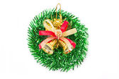 Green christmas wreath with golden bells. — Stock Photo
