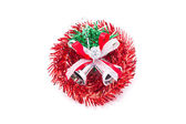 Red christmas wreath with silver bells. — Stock Photo