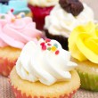 Group of cupcakes with sprinkles. shallow DOF. — Stock Photo